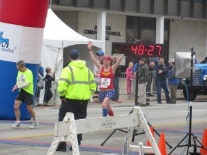 Me crossing the finish line of the Rodes City Run 10K