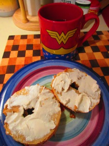 Sweet Note Gluten Free Garlic Bagels with a schmear of Tofutti Better Than Cream Cheese and Coffee!!