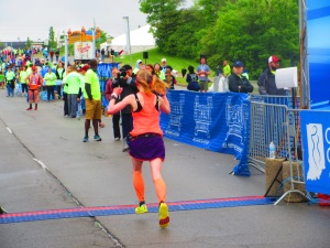 Me crossing the finish line of the Geist Half Marathon - Fishers, IN