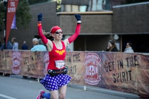 Me crossing the finish line of the Urban Bourbon Half Marathon - Louisville, KY
