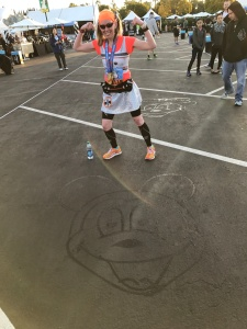 Me after finishing the Disneyland Star Wars Light Side Half Marathon and completing the Rebel Challenge