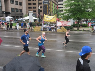 Melissa & Paul running through the rain to the finish line of the Bluegrass 10,000